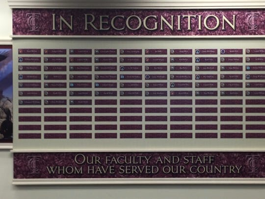 Plaques recognizing TCC student veterans are displayed on the walls of the Veteran Success Center.