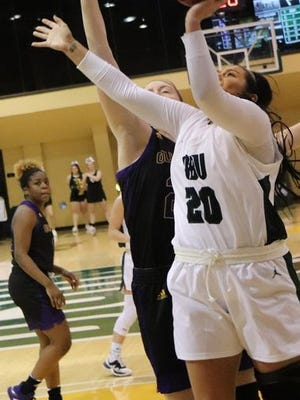 Oklahoma Baptist University's Mckenzie Cooper (20) puts up a shot against Ouachita Baptist Thursday night at the Noble Complex.     PHOTO BY BRIAN JOHNSON