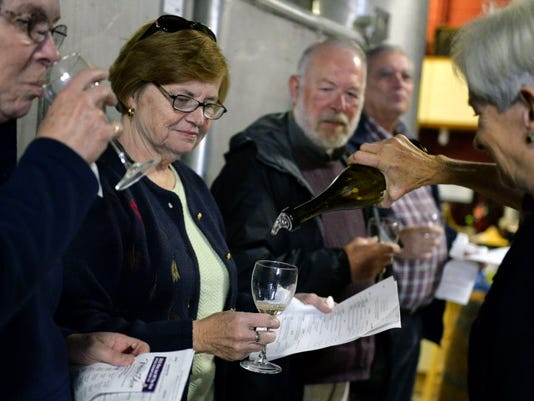 Allegro Winery's Cindy Alexander, right, pours a sample of Fanfare -- a Chardonnay blend -- for Linda Renner of Bel Air, Md., as Renner's friend Ellen Smith, left, takes a sip during the 2013 Wine Just Off the Vine.