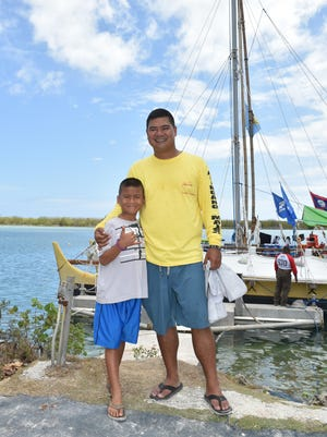 Ivan Blanco, right, takes a picture with his son Kideichi Mori Blanco, 8, at the Agana Boat Basin in Hagatna on May 28.