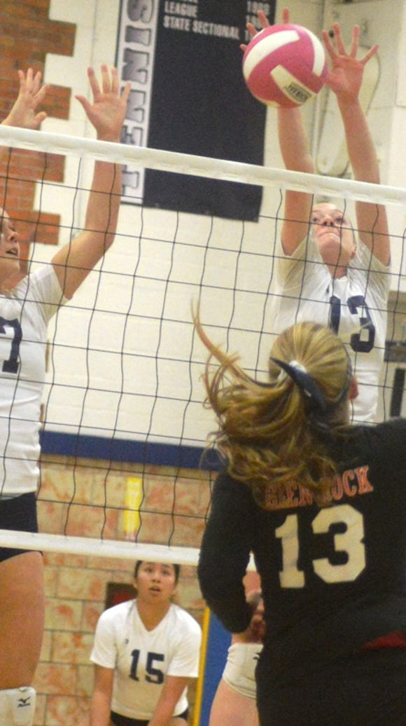 Rutherford volleyball player Jenna Rogers (13, facing) led North Jersey with 343 kills in 2017.