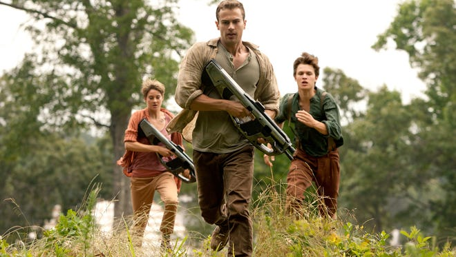 "From left, Shailene Woodley, Theo James and Ansel Elgort are on the run in ""Insurgent."""