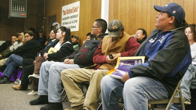 Dozens of people wait at M&M Tax Services on Main Street on Jan. 31, 2011. A measure working its way through the U.S. House of Representatives would result in big changes to the tax code.
