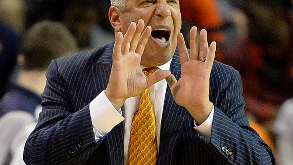 "FILE - In this Nov. 14, 2014, file photo, Auburn head coach Bruce Pearl talks to his players during an NCAAA college basketball game against Milwaukee in Auburn, Ala. Auburn's first-year coach is laboring through a season with a team that's new to him, and largely new to each other, but says, ""I really enjoy this team."" (AP Photo/AL.com, Julie Bennett, File)"