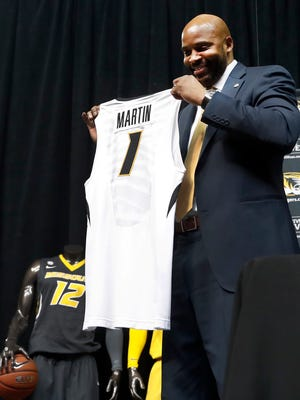 Cuonzo Martin holds a jersey presented to him after he was introduced as Missouri men's basketball coach Monday, March 20, 2017, in Columbia, Mo. Martin spent the past three seasons as coach at California and comes to Missouri with hopes he can revive the struggling program.