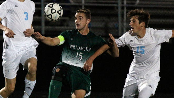 Williamston's Jack Bellinger, left, and Lansing Catholic's Jack Gonzalez vie for the ball Wednesday, Oct. 19, 2016, in Lansing, Mich.
