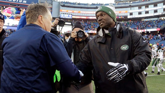 Patriots head coach Bill Belichick, left, and  Jets head coach Todd Bowles speak at midfield after the game.