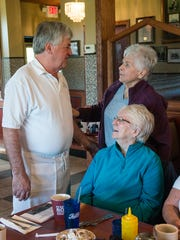 George Dimopoulos speaks with a group of customers, including Carole McLaughlin of Northville and Diane Hanosh of Plymouth. They belong to a group of regular customers called The Mermaids. They meet at Schoolcraft College's pool for a swimming fitness class, then head for breakfast at Senate.
