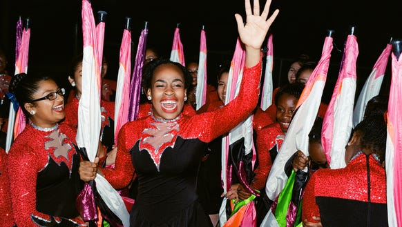 The Immokalee High School color guard cheer together