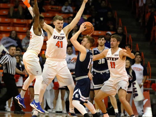 UTEP defenders, including Matt Willms, 41, surround Miles Lester, 11, of Rice when the Miners began pulling away from the Owls in the second half Saturday night in the Don Haskins Center.