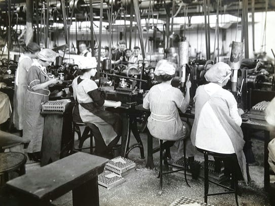 In this 1918 photo, women assemble munitions in the International Arms & Fuze Company in Bloomfield.