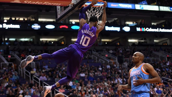 Mar 28, 2018: Phoenix Suns guard Shaquille Harrison (10) dunks over LA Clippers forward C.J. Williams (9) during the first half at Talking Stick Resort Arena.