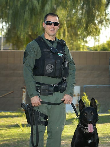 Goodyear Police Officer Josh White and his K9, Rudy in Goodyear. The pair won first place in a building search competition, distinguishing his K-9 abilities during the Desert Dog Police K-9 Trials held in Scottsdale.