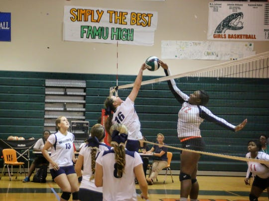 The Aucilla Christian volleyball team plays a match