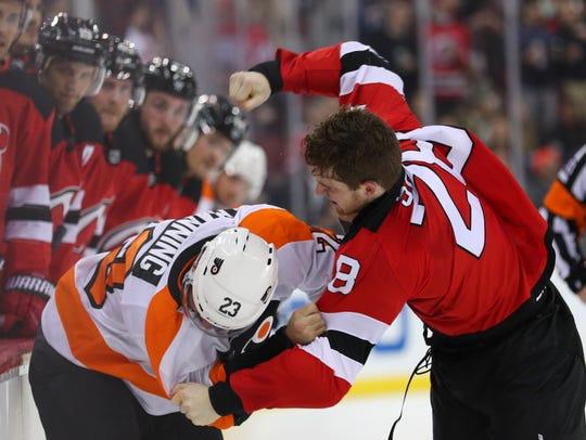 New Jersey Devils defenseman Damon Severson (28) and