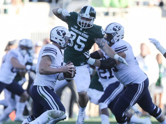 spartan football player returned michigan case