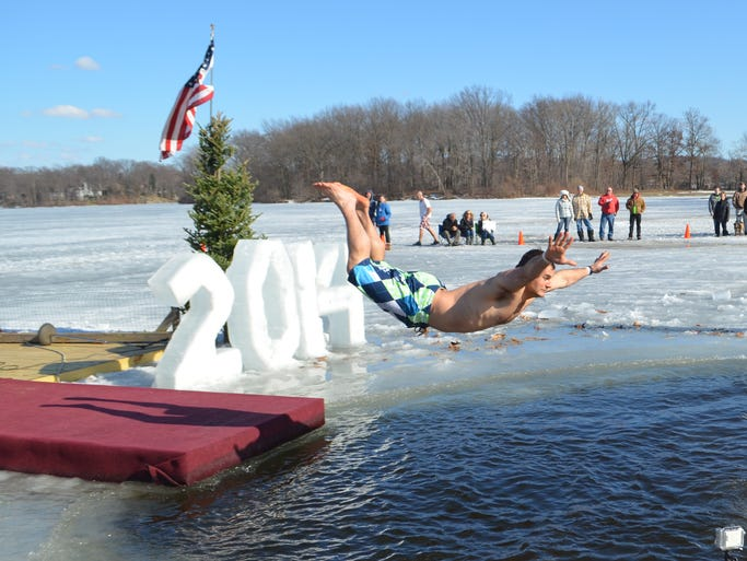 Feb . 22, 2014: 860 people braved the icy waters at Portage Lakes State Park to raise more than $100,000 for various local charities.