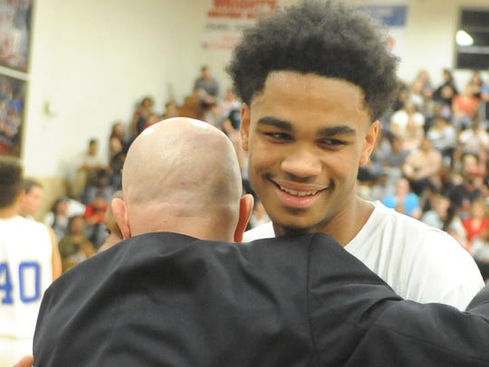 Lee High senior Manny Johnson comes out of the game