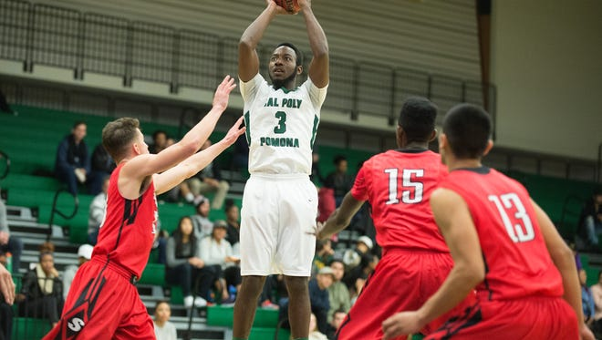 Quentin Taylor gets off a shot during the Broncos win over Cal State Stanislaus January 7, 2015.