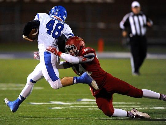 Sweetwater linebacker Mason Maxwell (34) tackles Krum linebacker Josh Cummins (48) during the third quarter of the Mustang's 40-14 win on Friday, Nov. 18, 2016, at Tarleton Memorial Stadium in Stephenville.