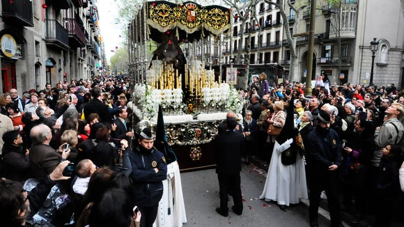 Rose petals rain on the Easter procession in Barcelona.