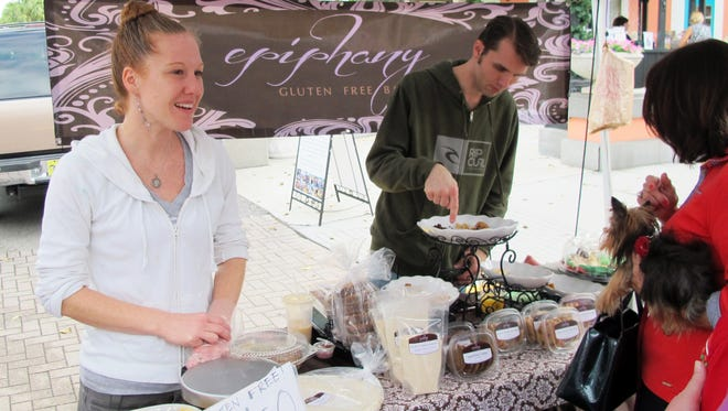 Local baker Ruth Wardein, left, chats with customers Dec. 17 at her tent for Epiphany Gluten Free Bakery at the Third Street South Farmers Market in downtown Naples. She plans to open a gluten-free bakery, cafe and coffeehouse in Creekside Corners retail center in North Naples.