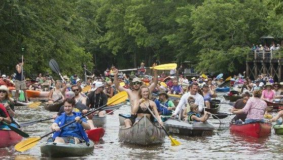 Kayaks, canoes and boats take to the Bayou Vermilion Sunday for the Bayou Vermilion Festival and Boat Parade.