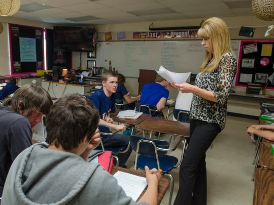English teacher Heather Belesky looks over an assignment