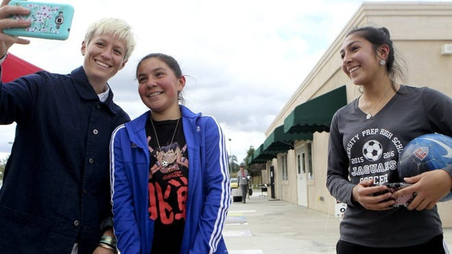 Greg Barnette/Record Searchlight Palo Cedro native Megan Rapinoe (left) takes a selfie with Olivia Rivera, 11, (center) and her older sister, Lilyana Rivera, 17, during a soccer celebration party Saturday evening at the Redding Soccer Park. The sisters drove to Redding from Victorville to see Rapinoe.