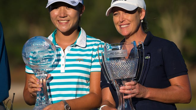 2015 Race to the CME Globe winner Lydia Ko, left, and 2015 CME Group Tour Championship winner Criste Kerr hold their trophies at the conclusion of the CME Group Tour Championship at Tiburon Golf Club on Sunday, Nov. 22, 2015, in North Naples.  Cristie Kerr won the event at 17-under, one stroke over Ha Na Jang and Gerina Piller.