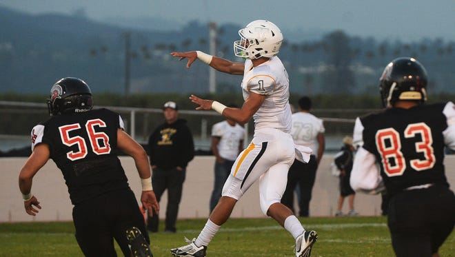 Ventura quarterback Jack Gutierrez throws on the run as Rio Mesa's Cristian Castellanos (56) and Justis Tinoco (83) follow the play during Friday night's game at Rio Mesa High,