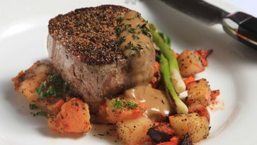 Dutch filet served atop a hutspot cake (a dish of boiled and mashed potatoes, carrots and onions with a long history in traditional Dutch cuisine).