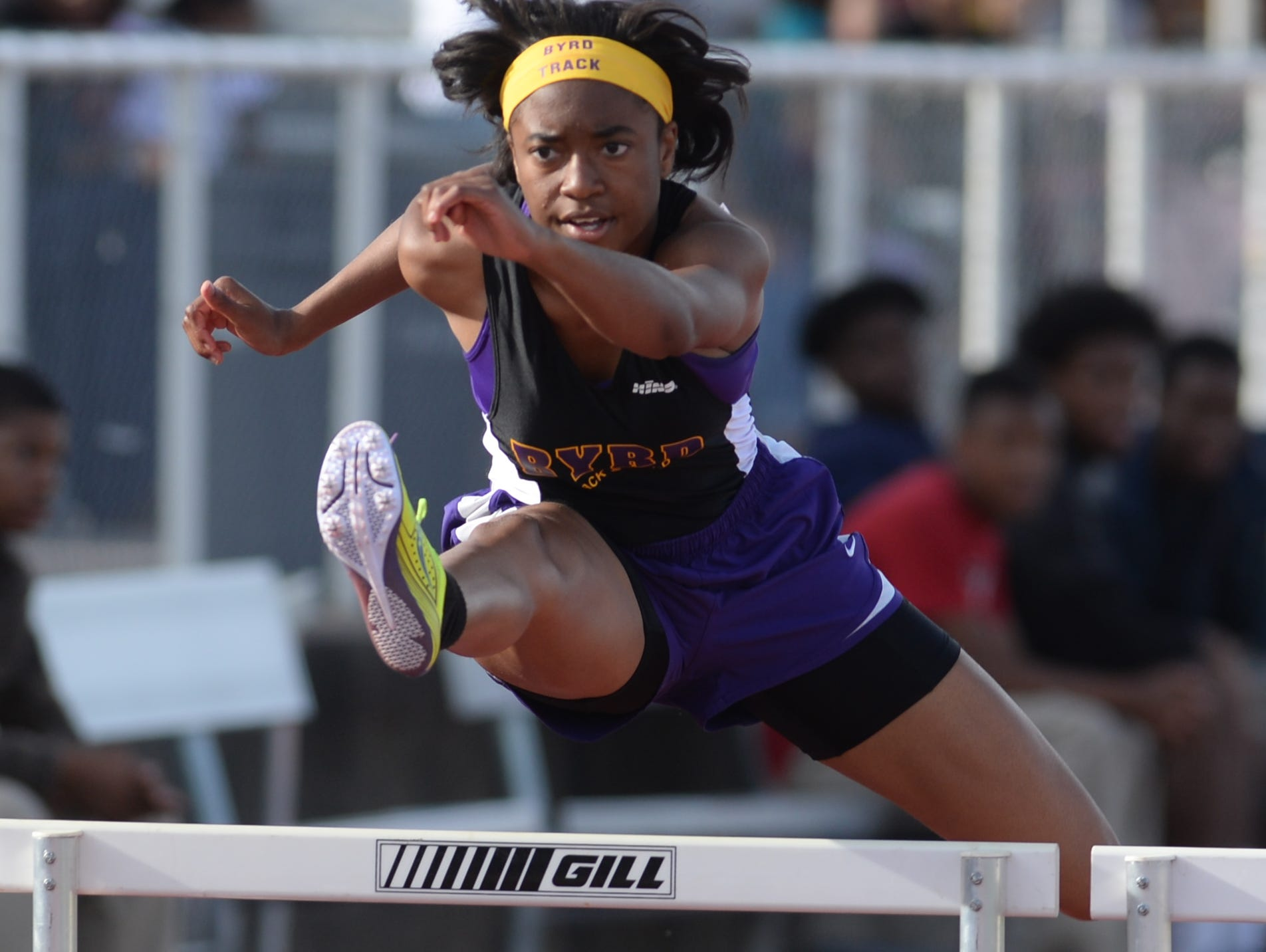Byrd's Naterria Davis takes the lead during her heat in the 100M hurdles at the Shreveport relays.