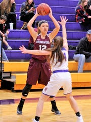 Brownwood's Sage Cupps is defended by Wylie's Mary Lovelace during Friday's District 5-4A opener. Cupps scored nine points in the loss.