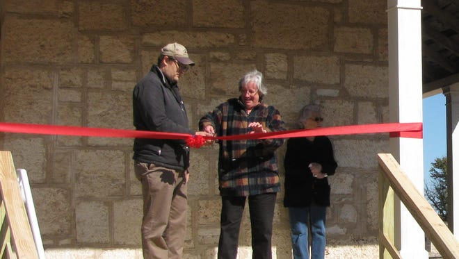 Fort McKavett State Historic Site Director Cody Mobley (left) and Lisa Lester (right), president of the Friends of Fort McKavett, cut a ribbon during the grand reopening of the visitor's center and museum on Saturday. Both are located in the fort's former hospital, built in 1873.