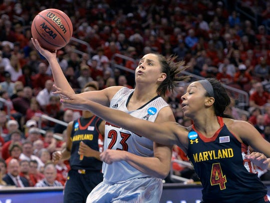 Maryland's Lexie Brown, right, attempts to knock the ball away from Louisville's Shoni Schimmel during the second half in a regional final of the NCAA women's college basketball tournament Tuesday, April 1, 2014, in Louisville, Ky. Maryland won 76-73. (AP Photo/Timothy D. Easley)