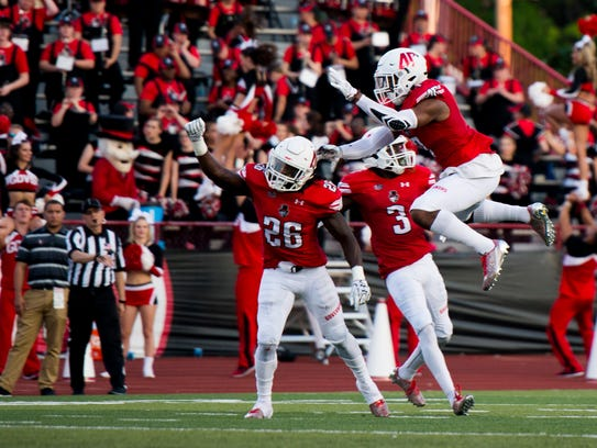 Austin Peay players celebrate after making a tackle