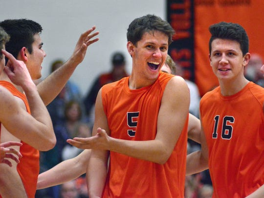 Northeastern's Nate Wilson (5) is congratulated by his teammates after a point during Tuesday's win over York Suburban. The Bobcats will host their own invitational on Saturday. It's considered one of the premier high school tournaments in the state. Bil Bowden photo
