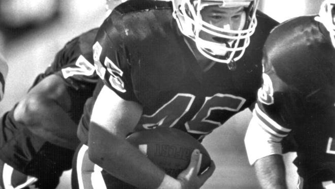 Adam Dach set an IHSA state record for rushing yards his senior season at Byron and then went on to rush for more than 700 yards all four years as an NIU fullback.