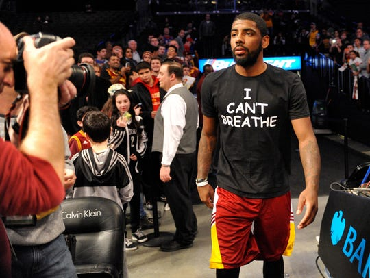 "Cleveland Cavaliers guard Kyrie Irving wears an ""I"