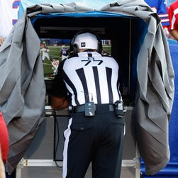 Aug 23, 2014; Orchard Park, NY, USA; NFL referee Terry McAulay (77) watches a replay during a game between the Buffalo Bills and the Tampa Bay Buccaneers at Ralph Wilson Stadium. Tampa Bay beats Buffalo 27 to 14.  Mandatory Credit: Timothy T. Ludwig-USA TODAY Sports usp ORG XMIT: USATSI-180652 [Via MerlinFTP Drop]