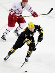 Green Bay Gamblers forward Brock Caufield brings the puck up the ice against the Dubuque Fighting Saints in a Clark Cup playoff game at the Resch Center on April 17.