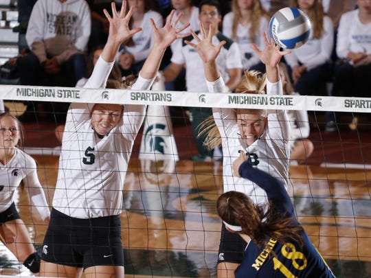 Michigan State's Holly Toliver, right, and Megan Tompkins,