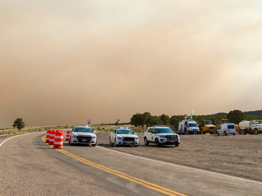A roadblock is set up on Highway 143 in Panguitch to