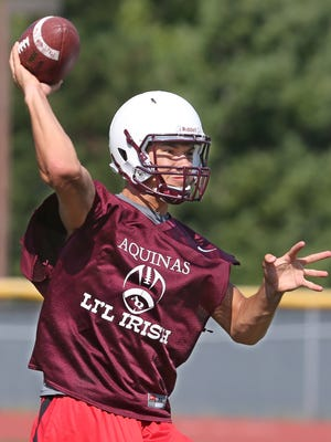 Aquinas QB Jake Zembiec fires a pass downfield during practice in August.