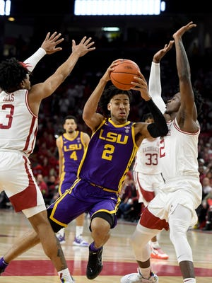 LSU forward Trendon Watford (2) tries to drive past Arkansas defenders Desi Sills(3) and Adrio Bailey(2) during the second half of an NCAA college basketball game Wednesday, March 4, 2020, in Fayetteville, Ark. (AP Photo/Michael Woods)