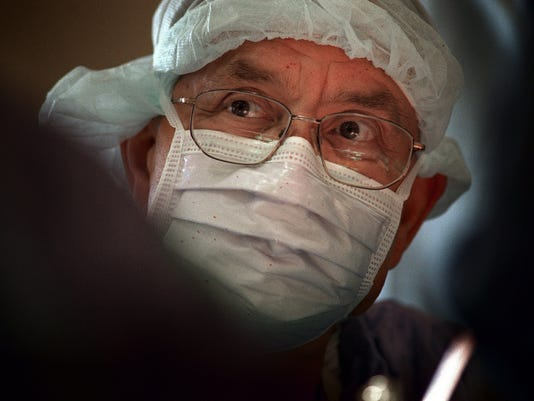 Dr. W. Dudley Johnson performs Coronary Bypass Surgery
