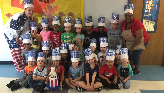 Students in Tina Mayse's class at the Day Nursery Sherry Lane Center celebrate the Winter Olympics with Abilene ISD pre-k teacher MacKenzie Jenness.