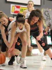 Salem Academy's Kara Standridge fights for the ball