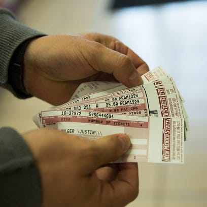 Justin Bulger, shows the tickets he bought Monday Dec.